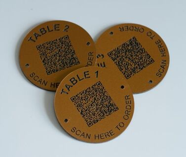 An image of Matte Brass Effect QR Code Table Numbers - 70mm
