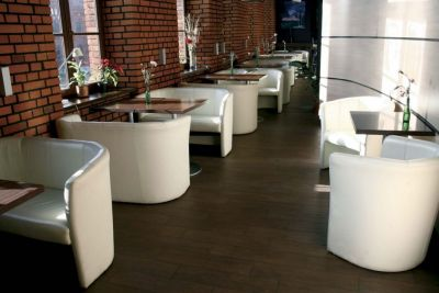Bistro Areat With Leather Tub Chairs And Sofas