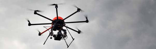 Flying drones to monitor and check construction site waste levels