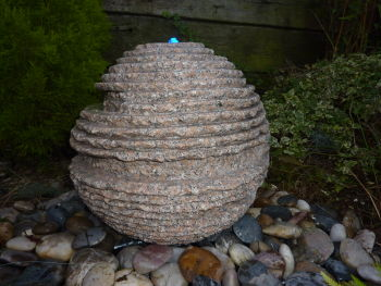 Rustic Sphere in Pink Granite 0.5m