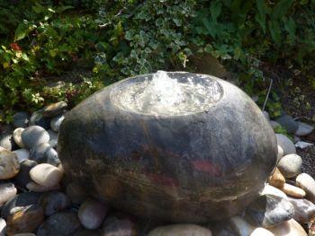 Polished Black Limestone Babbling Bowl